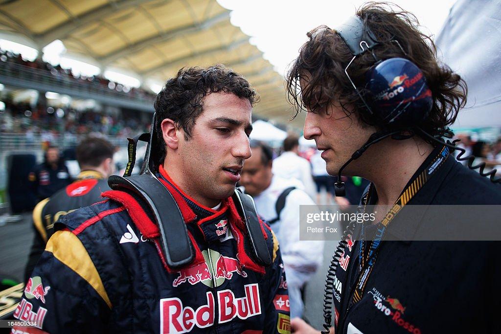 Daniel Ricciardo of Australia and Scuderia Toro Rosso speaks with Marco Matassa his Scuderia Toro Rosso Race Engineer before the Malaysian Formula One Grand Prix at the Sepang Circuit on March 24, 2013 in Kuala Lumpur, Malaysia.