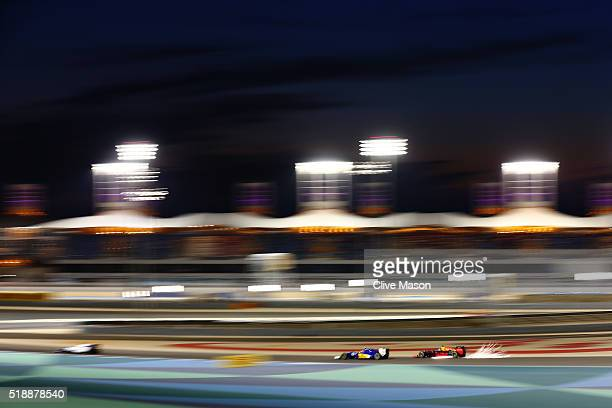 Daniel Ricciardo of Australia drives the Red Bull Racing Red BullTAG Heuer RB12 TAG Heuer chases down Felipe Nasr of Brazil drives the Sauber F1 Team...