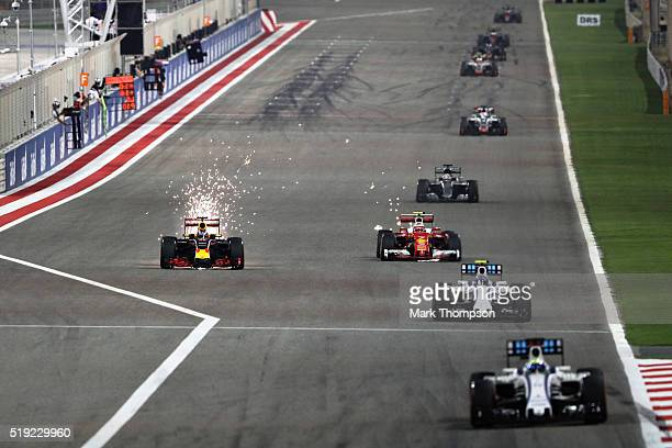 Daniel Ricciardo of Australia driving the Red Bull Racing Red BullTAG Heuer RB12 TAG Heuer sparks down the start finish straight alongside Kimi...