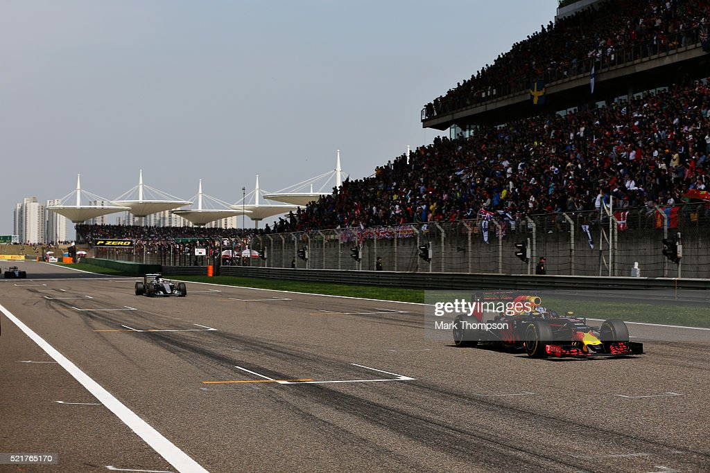 Daniel Ricciardo of Australia driving the Red Bull Racing Red BullTAG Heuer RB12 TAG Heuer leads Lewis Hamilton of Great Britain driving the Mercedes...