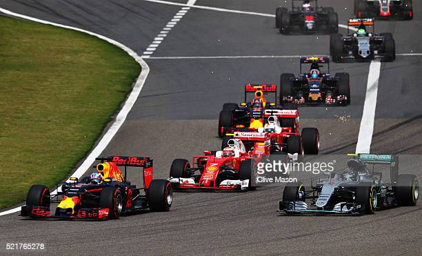 Daniel Ricciardo of Australia driving the Red Bull Racing Red BullTAG Heuer RB12 TAG Heuer leads Nico Rosberg of Germany driving the Mercedes AMG...