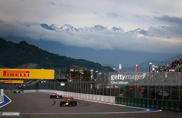 Daniel Ricciardo of Australia driving the Red Bull Racing Red BullTAG Heuer RB12 TAG Heuer ahead of Daniil Kvyat of Russia driving the Red Bull...