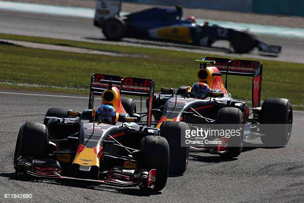 Daniel Ricciardo of Australia driving the Red Bull Racing Red BullTAG Heuer RB12 TAG Heuer leads Max Verstappen of the Netherlands driving the Red...