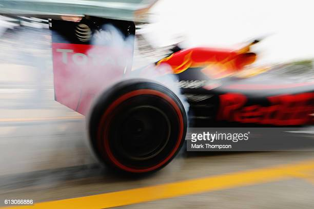 Daniel Ricciardo of Australia driving the Red Bull Racing Red BullTAG Heuer RB12 TAG Heuer spins up his wheels in the Pitlane during practice for the...