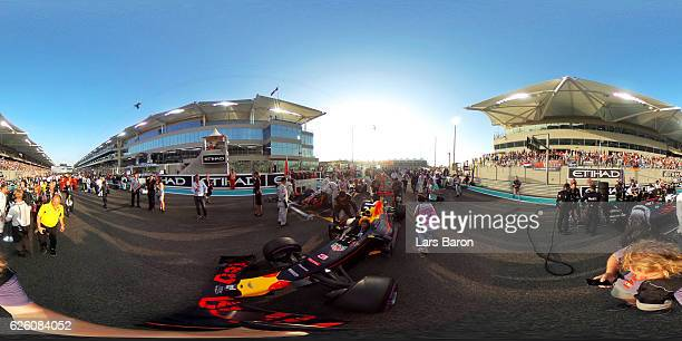 Daniel Ricciardo of Australia driving the Red Bull Racing Red BullTAG Heuer RB12 TAG Heuer is pushed onto the grid for the Abu Dhabi Formula One...