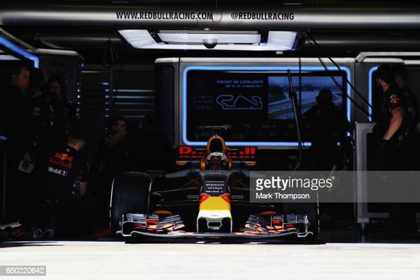 Daniel Ricciardo of Australia driving the Red Bull Racing Red BullTAG Heuer RB13 TAG Heuer leaves the garage during day three of Formula One winter...