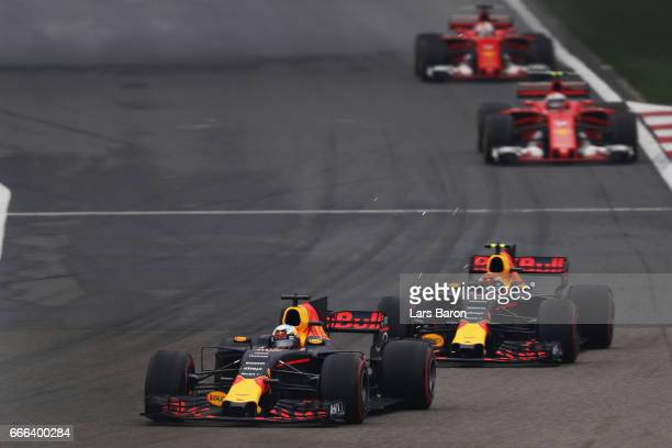 Daniel Ricciardo of Australia driving the Red Bull Racing Red BullTAG Heuer RB13 TAG Heuer leads Max Verstappen of the Netherlands driving the Red...