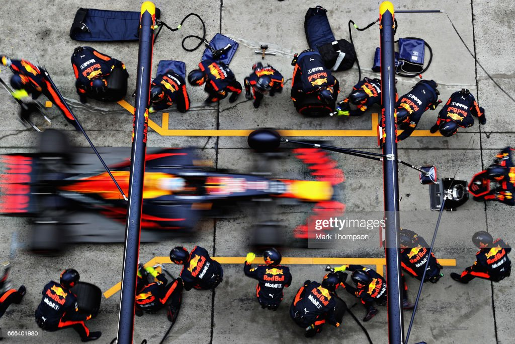 Daniel Ricciardo of Australia driving the (3) Red Bull Racing Red Bull-TAG Heuer RB13 TAG Heuer makes a pit stop for new tyres during the Formula One Grand Prix of China at Shanghai International Circuit on April 9, 2017 in Shanghai, China.