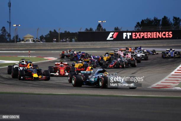 Daniel Ricciardo of Australia driving the Red Bull Racing Red BullTAG Heuer RB13 TAG Heuer follows Lewis Hamilton of Great Britain driving the...