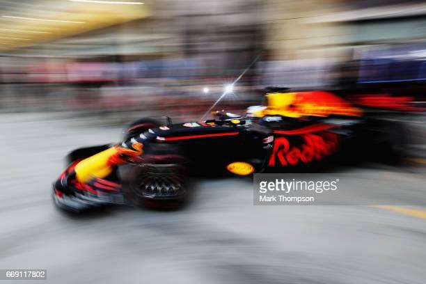 Daniel Ricciardo of Australia driving the Red Bull Racing Red BullTAG Heuer RB13 TAG Heuer leaves the garage before the Bahrain Formula One Grand...