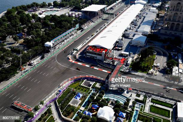 Daniel Ricciardo of Australia driving the Red Bull Racing Red BullTAG Heuer RB13 TAG Heuer leads Nico Hulkenberg of Germany driving the Renault Sport...