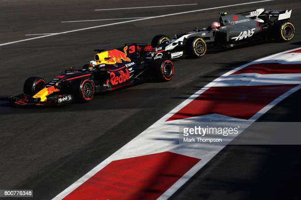 Daniel Ricciardo of Australia driving the Red Bull Racing Red BullTAG Heuer RB13 TAG Heuer leads Kevin Magnussen of Denmark driving the Haas F1 Team...