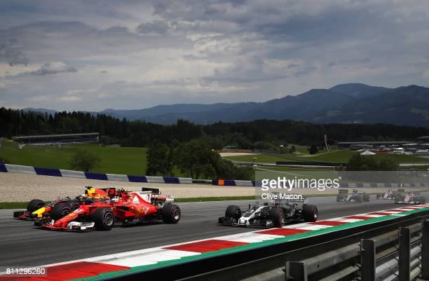 Daniel Ricciardo of Australia driving the Red Bull Racing Red BullTAG Heuer RB13 TAG Heuer Kimi Raikkonen of Finland driving the Scuderia Ferrari...