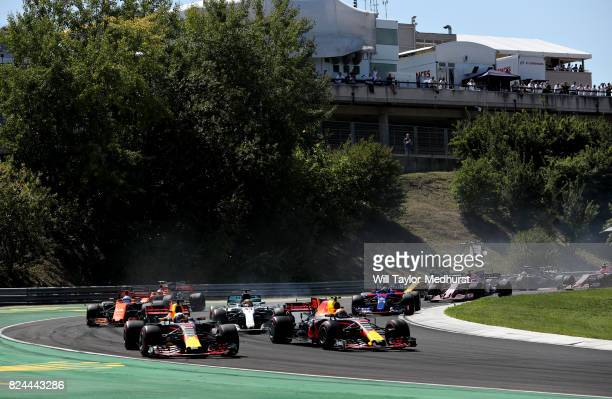 Daniel Ricciardo of Australia driving the Red Bull Racing Red BullTAG Heuer RB13 TAG Heuer and Max Verstappen of the Netherlands driving the Red Bull...