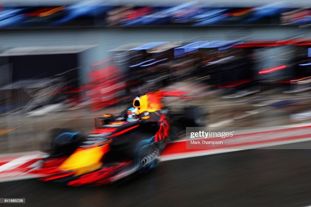 Daniel Ricciardo of Australia driving the (3) Red Bull Racing Red Bull-TAG Heuer RB13 TAG Heuer leaves the garage during qualifying for the Formula One Grand Prix of Italy at Autodromo di Monza on September 2, 2017 in Monza, Italy.