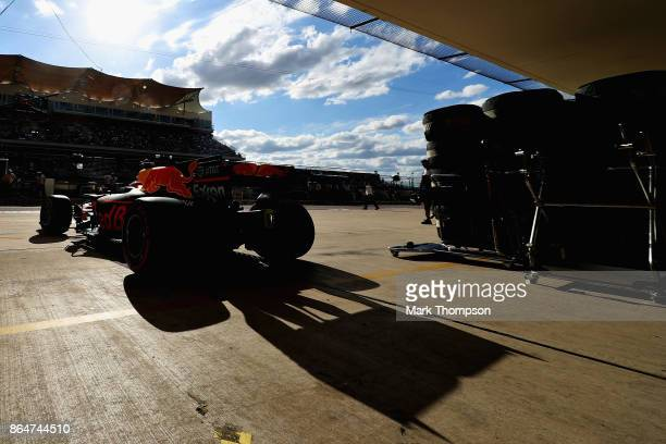Daniel Ricciardo of Australia driving the Red Bull Racing Red BullTAG Heuer RB13 TAG Heuer leaves the garage during qualifying for the United States...