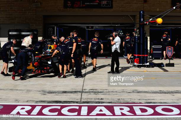 Daniel Ricciardo of Australia driving the Red Bull Racing Red BullTAG Heuer RB13 TAG Heuer is pushed back into the garage during qualifying for the...
