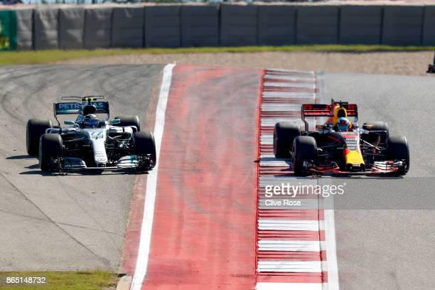 Daniel Ricciardo of Australia driving the Red Bull Racing Red BullTAG Heuer RB13 TAG Heuer and Valtteri Bottas driving the Mercedes AMG Petronas F1...