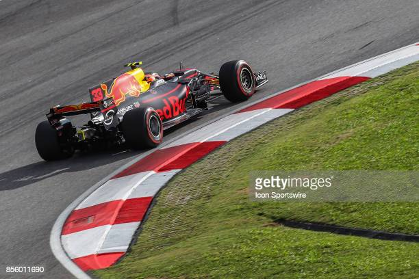 Daniel Ricciardo of Red Bull Racing in action during the qualifying session of the Formula 1 Petronas Malaysia Grand Prix held at Sepang...