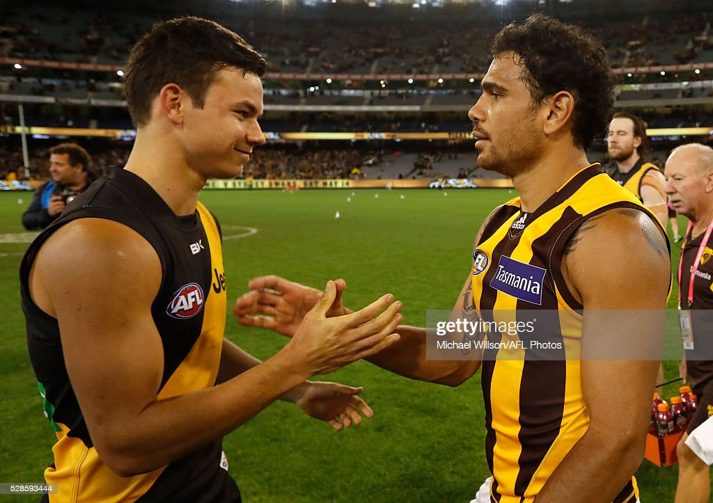 Daniel Rioli of the Tigers and <a gi-track='captionPersonalityLinkClicked' href=/galleries/search?phrase=Cyril+Rioli&family=editorial&specificpeople=681811 ng-click='$event.stopPropagation()'>Cyril Rioli</a> of the Hawks embrace after the 2016 AFL Round 07 match between the Richmond Tigers and the Hawthorn Hawks at the Melbourne Cricket Ground, Melbourne on May 6, 2016.