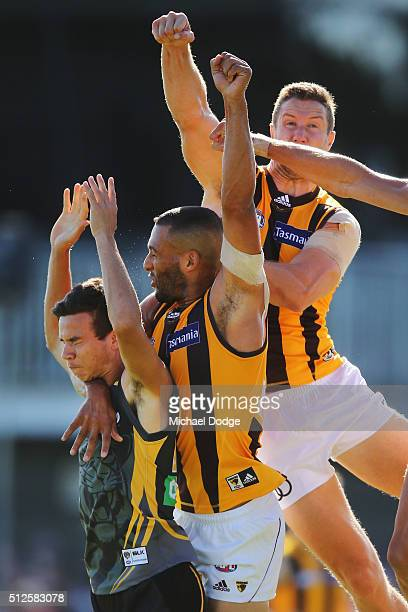 Daniel Rioli of the Tigers competes for the ball Josh Gibson and James Frawley of the Hawks during the 2016 AFL NAB Challenge match between the...