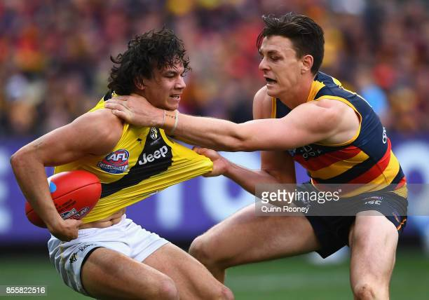 Daniel Rioli of the Tigers is tackled by Jake Lever of the Crows during the 2017 AFL Grand Final match between the Adelaide Crows and the Richmond...