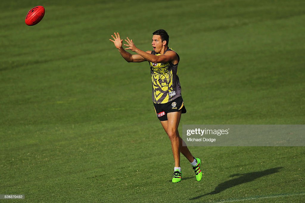 Daniel Rioli of the Tigers marks the ball during a Richmond Tigers AFL training session at Punt Road Oval on May 5, 2016 in Melbourne, Australia.