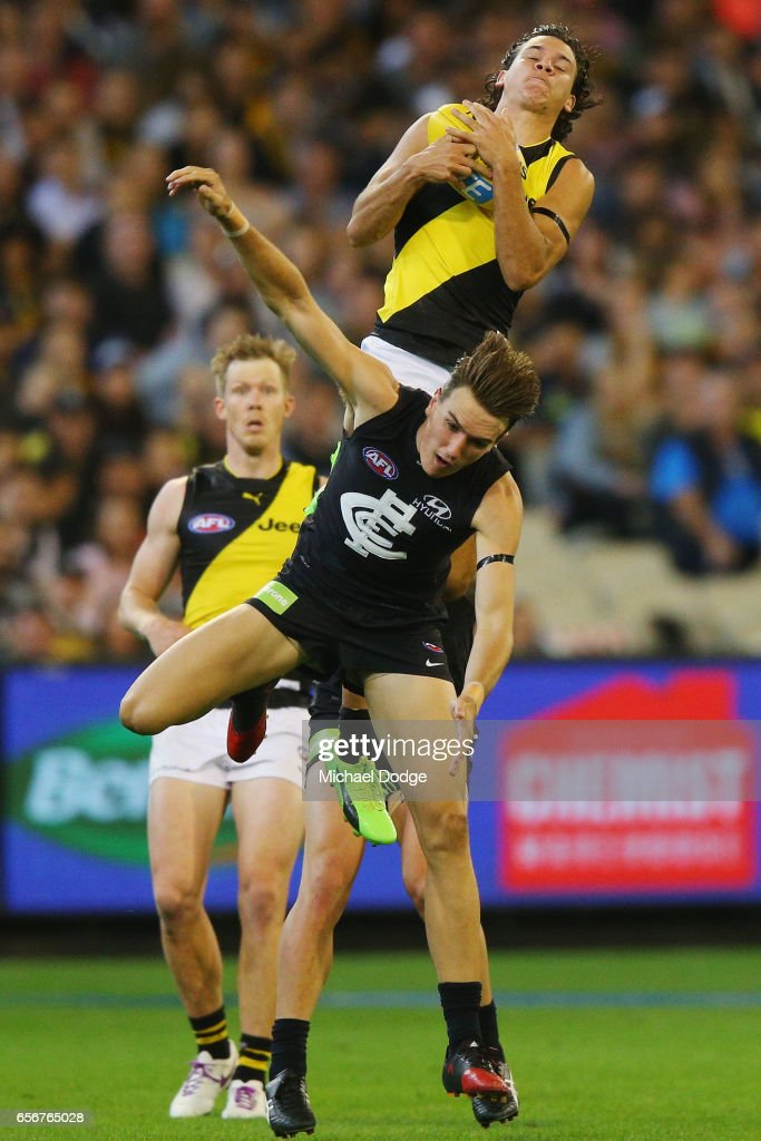 Daniel Rioli of the Tigers marks the ball over Patrick Cripps of the Blues during the round one AFL match between the Carlton Blues and the Richmond Tigers at Melbourne Cricket Ground on March 23, 2017 in Melbourne, Australia.