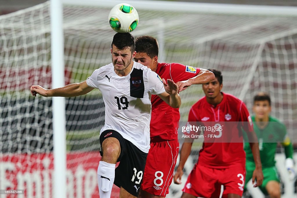 Daniel Ripic (front) of Austria jumps for a header with <a gi-track='captionPersonalityLinkClicked' href=/galleries/search?phrase=Jose+Lopez&family=editorial&specificpeople=239051 ng-click='$event.stopPropagation()'>Jose Lopez</a> of Canada during the FIFA U-17 World Cup UAE 2013 Group E match between Canada and Austria at Al Rashid Stadium on October 19, 2013 in Dubai, United Arab Emirates.