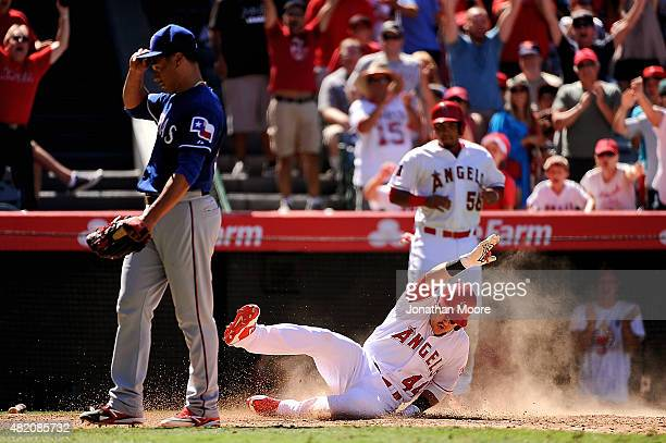 Daniel Robertson of the Los Angeles Angels of Anaheim scores on a throwing error by Rougned Odor of the Texas Rangers after hitting an infield home...