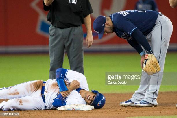TORONTO ON AUGUST 16 Daniel Robertson of the Rays checks on Ryan Goins of the Blue Jays after stepping on him as he slid into second base during the...