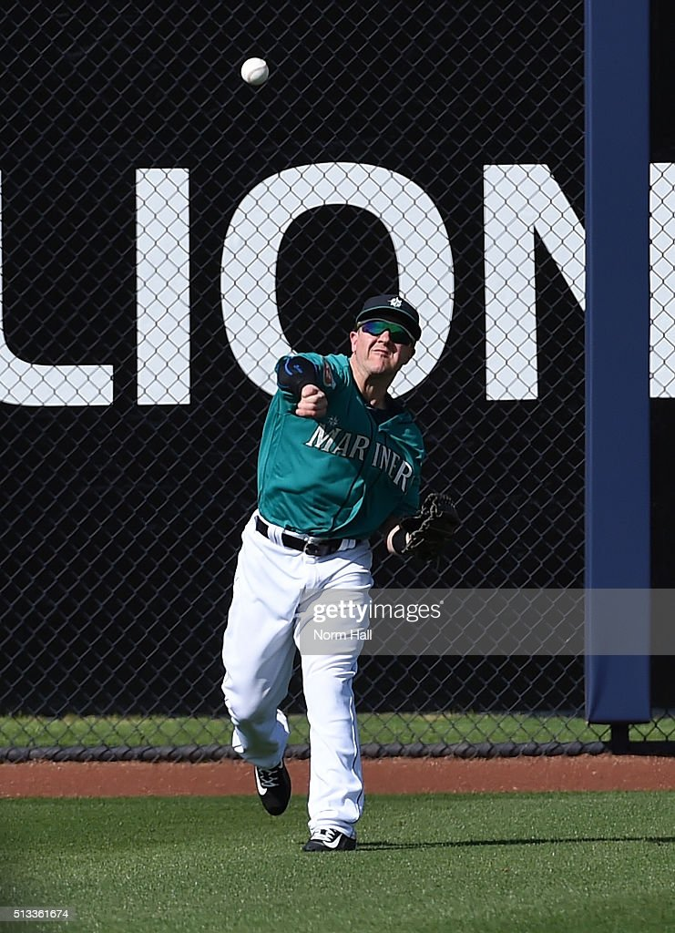 Daniel Robertson #99 of the Seattle Mariners throws the ball to second base from left field during the fifth inning against the San Diego Padres at Peoria Stadium on March 2, 2016 in Peoria, Arizona. Mariners won 7-0.