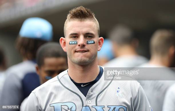 Daniel Robertson of the Tampa Bay Rays shows off his Father's Day eye black as he watches the action from the dugout during the second inning of the...