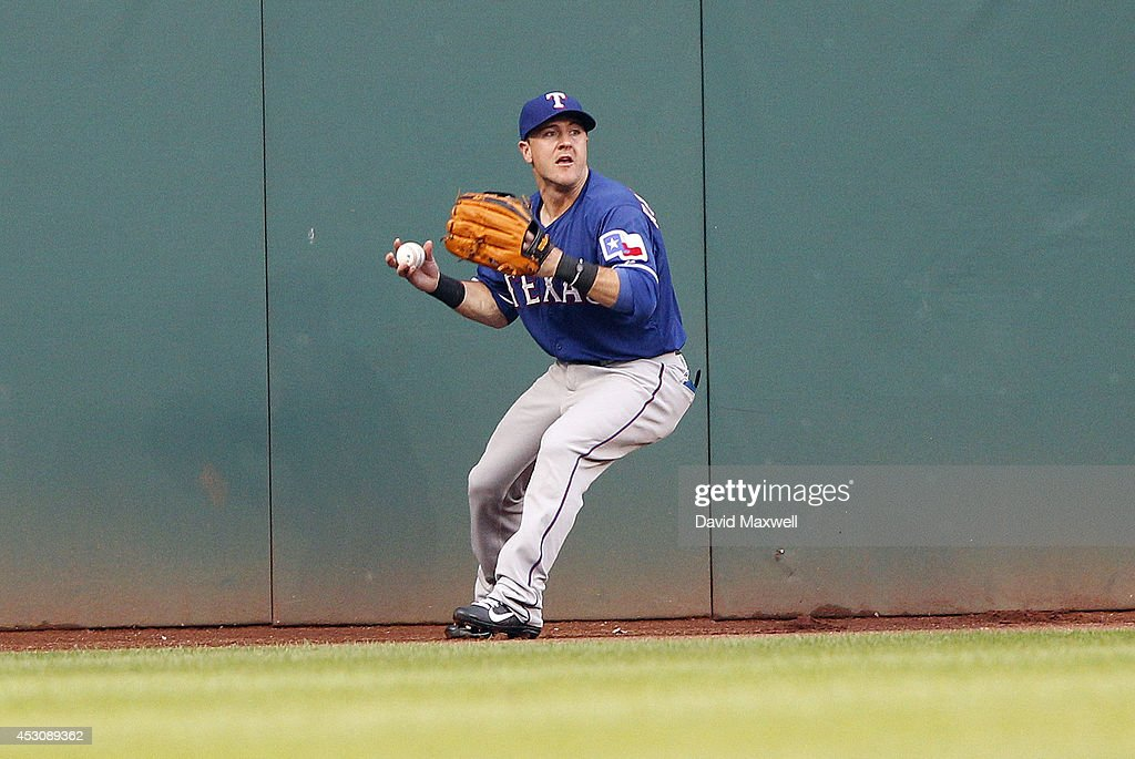 Daniel Robertson #19 of the Texas Rangers catches a ball hit by Carlos Santana #41 (not pictured) during the fourth inning of their game on August 2, 2014 at Progressive Field in Cleveland, Ohio.