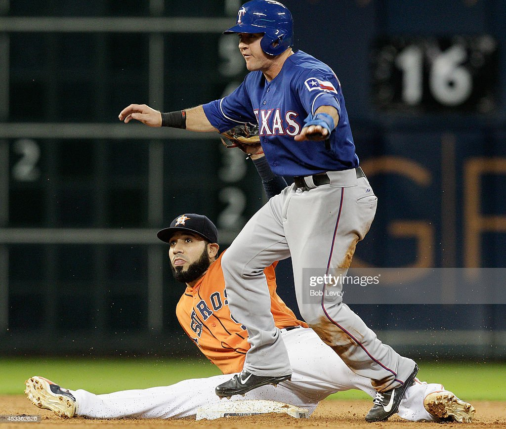 Daniel Robertson #19 of the Texas Rangers is called safe as Marwin Gonzalez #9 of the Houston Astros is late on the tag on a wild pitch in the seventh inning at Minute Maid Park on August 8, 2014 in Houston, Texas.