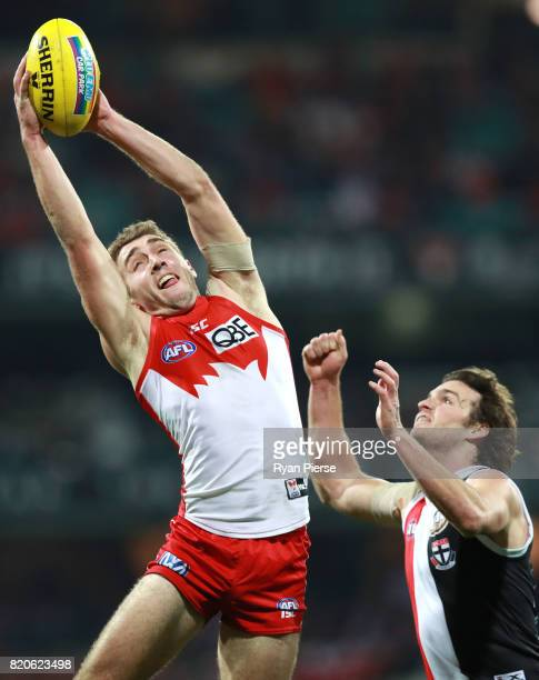 Daniel Robinson of the Swans marks over Dylan Robertson of the Saints during the round 18 AFL match between the Sydney Swans and the St Kilda Saints...