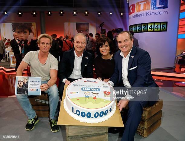 Daniel Roesner Carsten Teschner Birgit Schrowange and Wolfram Kons are seen in the studio of the RTL Telethon TV show on November 24 2016 in Cologne...