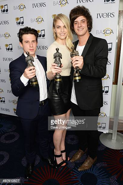 Daniel Rothman Hannah Reid and Dominic Major pose with their Best Song Award in the winners room at The Ivor Novello Awards at The Grosvenor House...