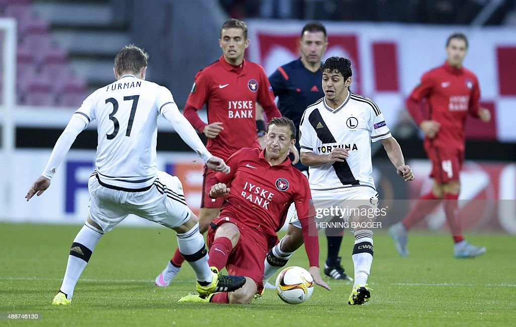 Daniel Royer of FC Midtjylland and Dominik Furman of Legia Warszawa vie for the ball during the UEFA Europa League Group D football match between FC...