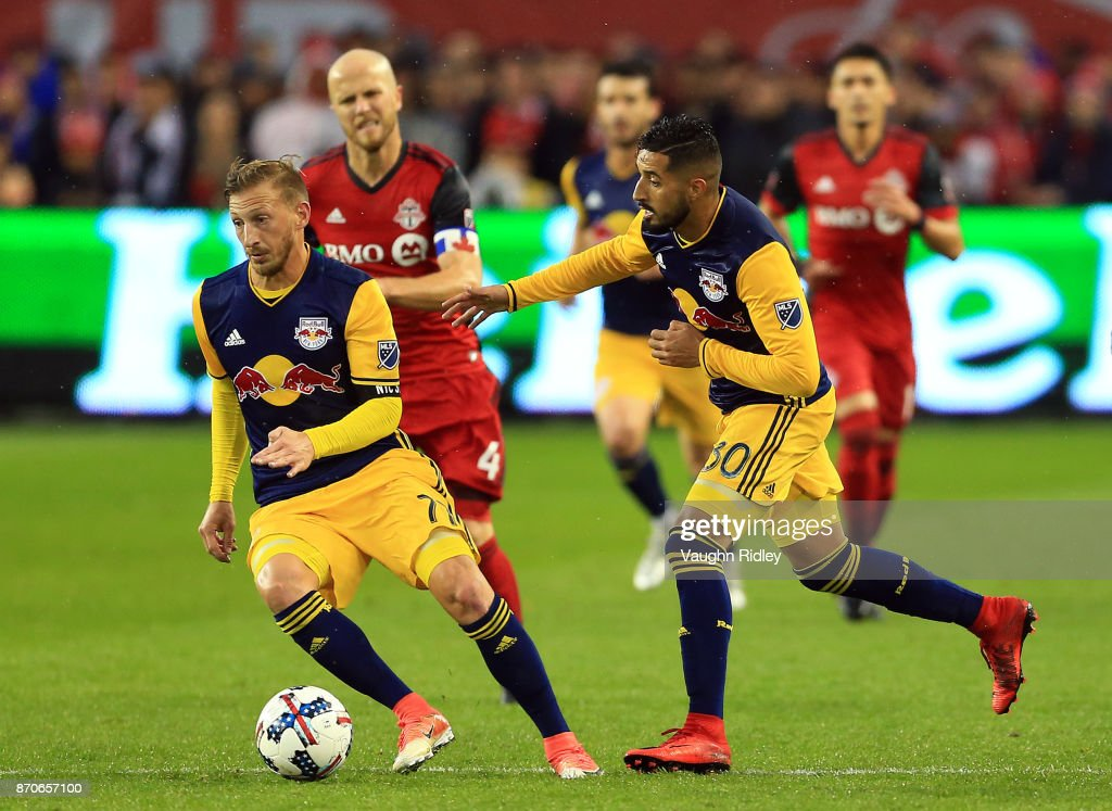 Daniel Royer #77 of New York Red Bulls dribbles the ball along with teammate Gonzalo Veron #30 during the second half of the MLS Eastern Conference Semifinal, Leg 2 game against Toronto FC at BMO Field on November 5, 2017 in Toronto, Ontario, Canada.