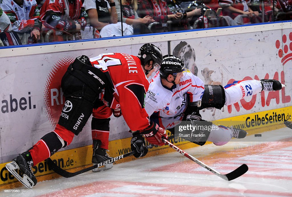 Daniel Rudslatt of Cologne challenges for the puck with Michael Bakos of Ingolstadt during the DEL playoff match between Koelner Haie and ERC...