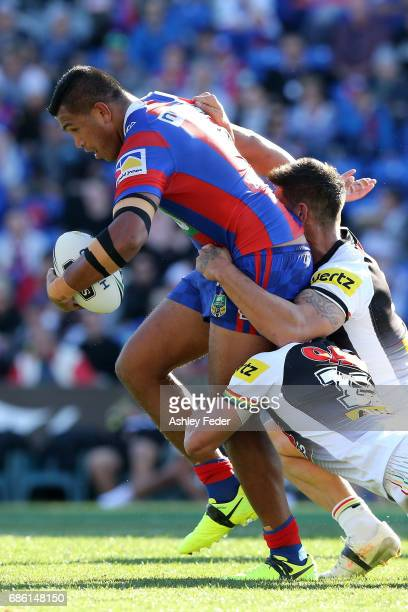 Daniel Saifiti of the Knights is tackled by the Panthers defence during the round 11 NRL match between the Newcastle Knights and the Penrith Panthers...