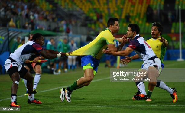 Daniel Sancery of Brazil holds off Carlin Isles of the United States and Madison Hughes of the United States to score a try during the Men's Rugby...