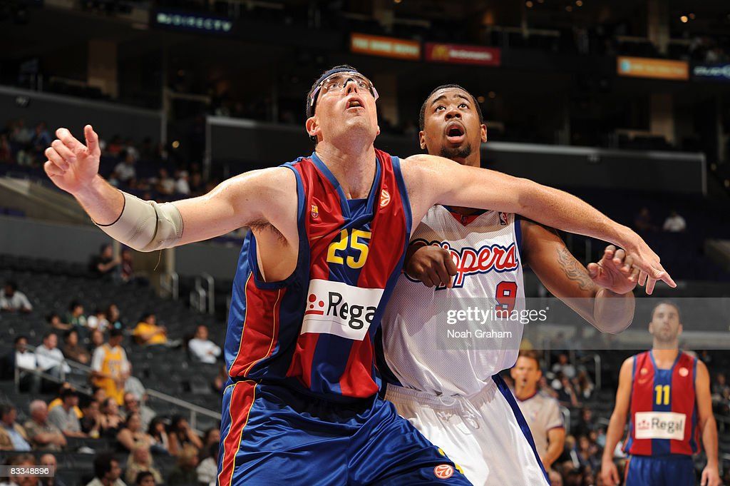 Daniel Santiago of Regal FC Barcelona boxes out against DeAndre Jordan of the Los Angeles Clippers at Staples Center on October 19 2008 in Los...
