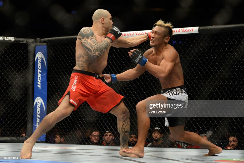Daniel Sarafian punches Kiichi Kunimoto during the UFC 174 event at Rogers Arena on June 14, 2014 in Vancouver, British Columbia, Canada.