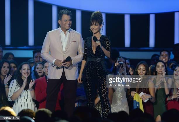Daniel Sarcos and Carmen Villalobos on stage at Telemundo's 2017 'Premios Tu Mundo' at American Airlines Arena on August 24 2017 in Miami Florida
