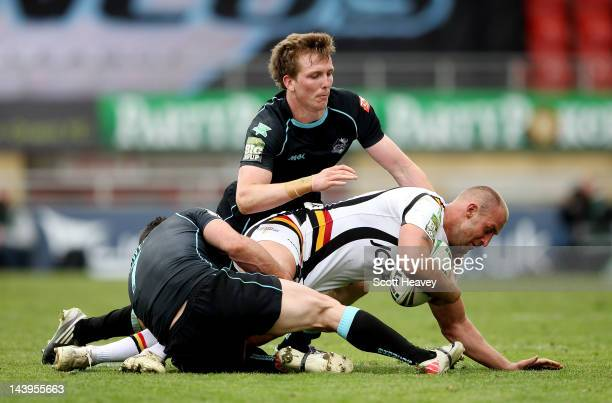 Daniel Sarginson of London Broncos challenges Michael Platt of Bradford Bulls during the Stobart Super League match between London Broncos and...