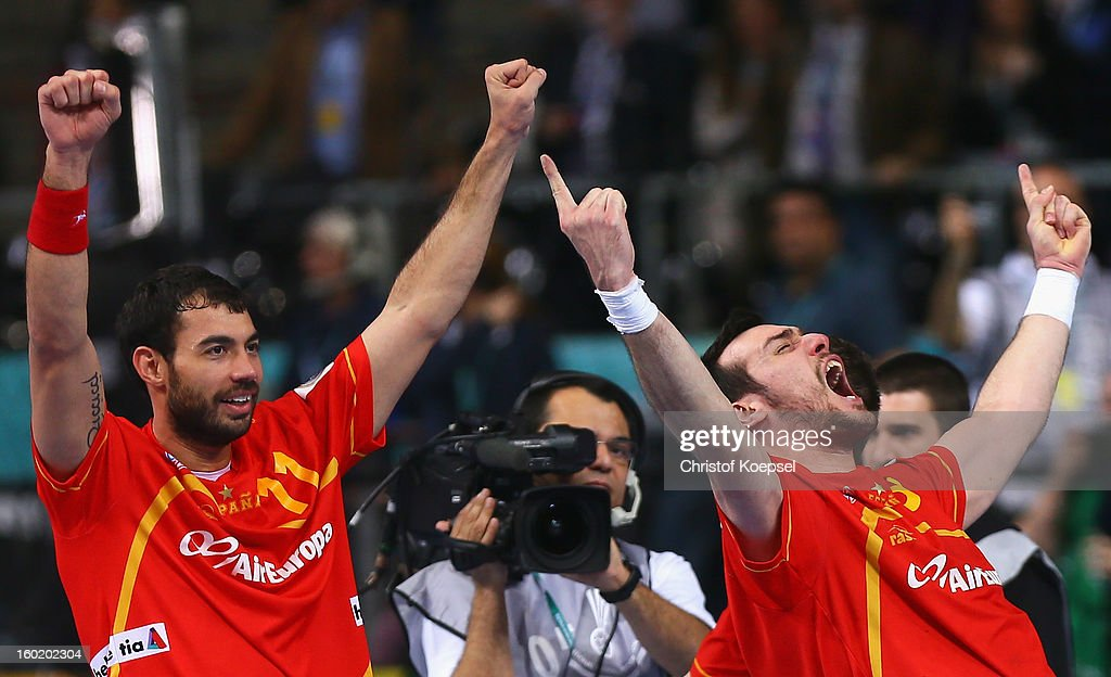 Daniel Sarmiento and Gedeon Guardiola of Spain celebrate winning the Men's Handball World Championship 2013 final match between Spain and Denmark at Palau Sant Jordi on January 27, 2013 in Barcelona, Spain.