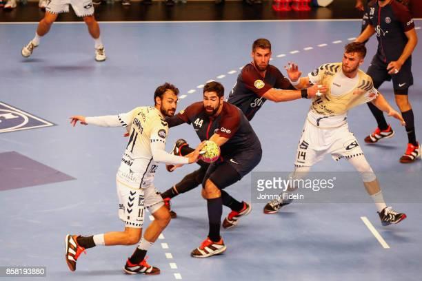 Daniel Sarmiento of Saint Raphael and Nikola Karabatic of PSG during the Lidl Starligue match between Paris Saint Germain and Saint Raphael on...