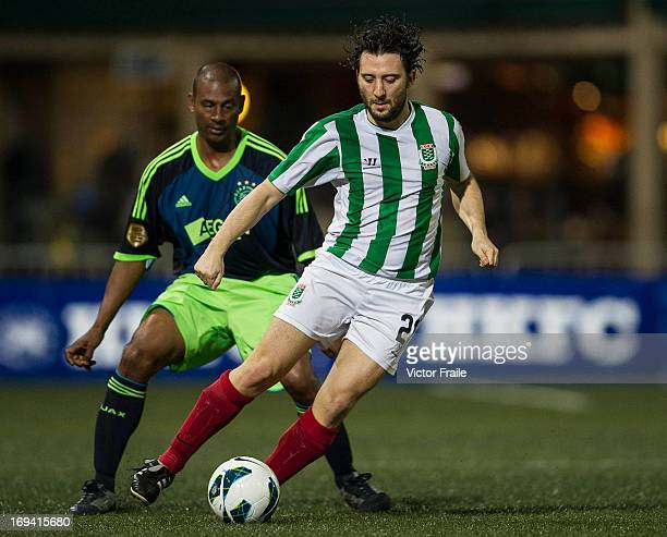 Daniel Schick of KCC Veterans in action against Aron Winter of Ajax All Stars on Day one of the Hong Kong International Soccer Sevens at Hong Kong...